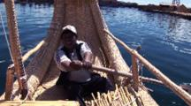 Man Rows Reed Boat On Lake Titicaca