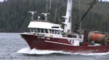 Red Family Fishing Boat Passing