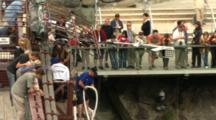 A Bungy Jumping Bridge With Onlookers.