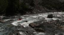 Wide-Mountain Shot, Tilts To Kayaker Running Rapids, Tilts Back To Mountain