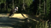A Mountain Biker Rides A Switchback Course Through The Woods.