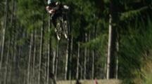 A Mountain Biker Straight Airs A Big Kicker.