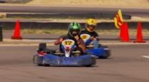 Go Karts Racing On A Track.