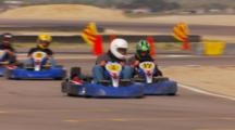 Go Karts Racing Around A Track.
