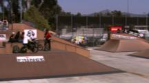 Tracking A Bmx Rider Doing A Big 360 At A Skate Park.