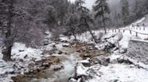 Water Flows In River During Snowfall