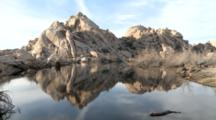 Calm Water Reflects Rock Formations In Joshua Tree National Park