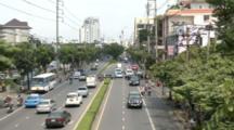 Traffic Moves Along Street In Bangkok, Thailand