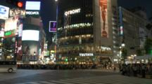 Many People, Cars Passing At Junction In Shibuya, Tokyo, Japan