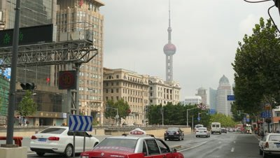 Vehicle Running on Road with Oriental Pearl Tower in background, Shanghai, China