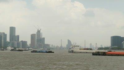 Cargo Ship Sailing on Huangpu River, Shanghai, China