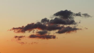Clouds Moving in Sky at Sunset