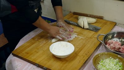 A Woman Making Dumpling Skin