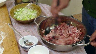 A Woman Making Dumpling Filling