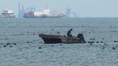 Fisherman at Work in Bohai Bay, Qinhuangdao, Hebei, China