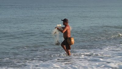 A Man Throwing Fishing Net into the Sea, Philipines