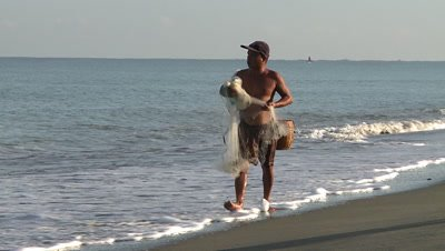 Men Walking on the Beach with Fishing Net, Philipines