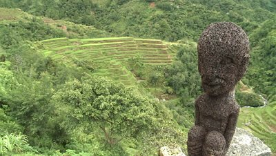 Statue with Banaue Rice Terraces as Background, Philippines