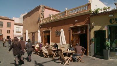 People relaxed at a café in Tenerife, Spain