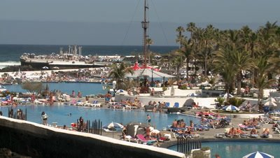 People enjoying the pool in Puerto de La Cruz, Tenerife, Spain,