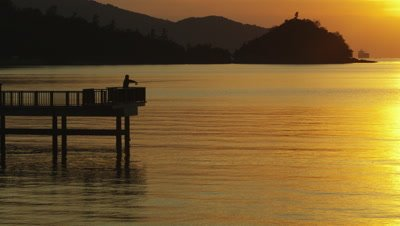 Silhouette of a man fishing and Seto Inland Sea