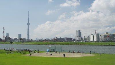 Kids playing baseball along Arakawa River in Tokyo, Japan