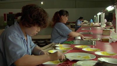 Workers Applying Decal on Plate in Ceramics Factory in Pingding, Yangquan, Shanxi, China