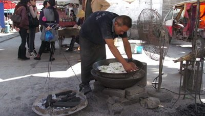 Man Placing the Flatten Dough on the Baking Tray, Dali, Yunnan, China