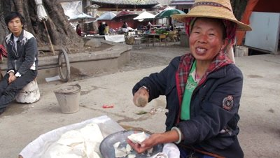 Woman Beating the Dough Piece with Mallet, Dali, Yunnan, China