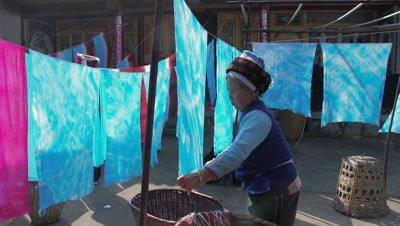 Women Sun Drying the Dyed Fabric, Dali, Yunnan, China