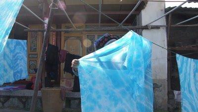 Women Taking down the Dried Fabric, Dali, Yunnan, China