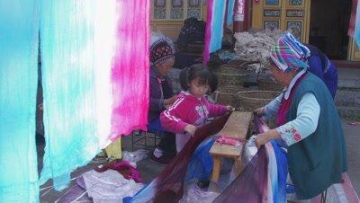 Women Tearing the Dyed Fabric, Dali, Yunnan, China