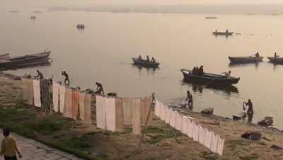 People Doing Laundry along the Ganges River, Varanasi, India
