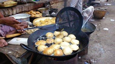 Indian Food Vendor Frying Puri at the Stall, Varanasi, India