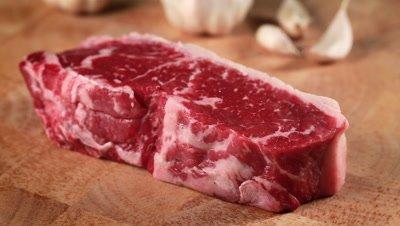 Raw Beef Steak Seasoned with Salt and Pepper