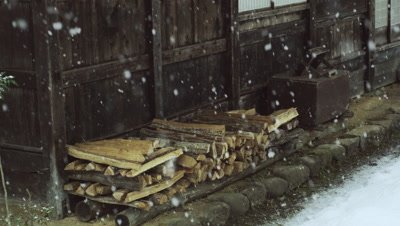 Firewood placed in front of a house