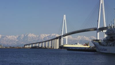 Ship moving under Shinminato Oohashi Bridge in Toyama Prefecture, Japan