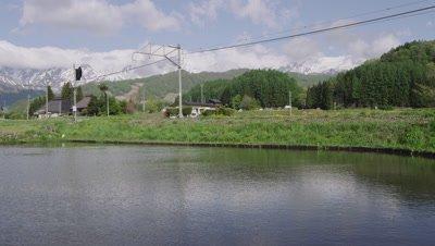 Train and Hakuba mountains in Nagano, Japan