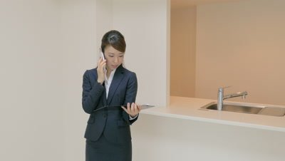 Real Estate Sales Talking on Mobile Phone