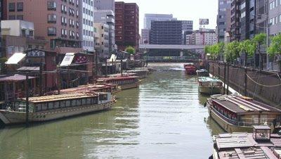 Boats moored at Kanda River in Tokyo, Japan