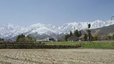 Local train traveling in front of Hakuba Mountain Range, Hakuba Village, Kitaazumi District, Nagano Prefecture, Japan