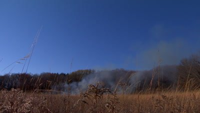 Fire starts to burn on a tallgrass prairie