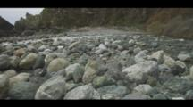 Colorful Rocks Fill The Shoreline Of A Coastal Beach, Calm Seas And Gulls Are In The Frame, Big Sur. Cine-Slider Shot.