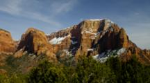 Snow On Red Rock Mountains, Pine Forest In Front. Zion National Park, Utah