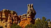 Red Rock Spires, Many Shapes And Layers. Windy And Breeze Moves The Trees. Utah.