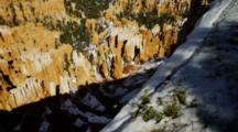 Snow Blankets Shrubby Manzanita Emerging In Spring Melt, Red Rock Canyon Beyond. Bryce Canyon National Park.