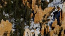 Red Rock Spires, Many Layers, With Trees And Snow. Shot Pans Up From Bottom. Utah.
