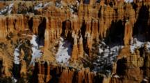 Red Rock Spires, Many Layers, With Trees And Snow. Utah.