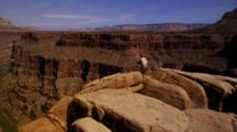 Red Rock Formations On The Rim Of The Grand Canyon With The Colorado River. Karen Ward Photographing.