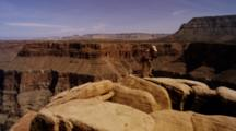 Grand Canyon Rim, Showing The Eroding Rock Layers. Shot Pans Left To Right, Karen Ward Photographing At Rim. Arizona.